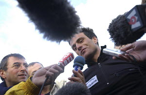 """Franck Cammas being interviewed during the Route du Rhum 2002. - For EDITORIAL use only. ^^^Cammas capsized his ORMA 60ft trimaran """"Groupama"""". Despite being near the shipping lanes north of Roscoff he... - Yvan Zedda"""