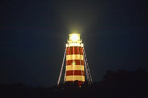 The kerosene fuelled light of Elbow Cay Lighthouse lit at night, Abacos Islands, Bahamas. - Onne van der Wal