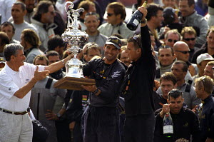 Russell Coutts (left) holding the America's Cup beside Dean Barker (with champagne) of Team New Zealand, after winning the 5th Race of the America's Cup 2000. Auckland, New Zealand.  -  Franck Socha