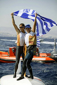 Sofia Bekatorou and Aimilia Tsoulfa celebrate after winning the Gold Medal in the Women's 470, Olympic Games, Athens, Greece, 19 August 2004.  Editorial Use Only.  -  Barry Bland