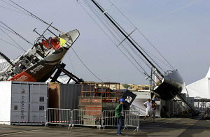 """""""Team New Zealand"""" and another of the America's Cup boats after being blown off their cradles by a violent storm on 11th September 2004, Louis Vuitton Act 1, Marseilles, France. ^^^ """"Team New Zealand""""... - Franck Socha"""