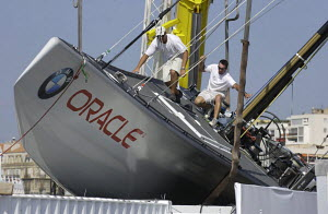 """""""Oracle"""" after being blown off its cradle by a violent storm on 11th September 2004, Louis Vuitton Act 1, Marseilles, France. ^^^ """"Team New Zealand"""", """"BMW Oracle Racing"""" and """"Team Alinghi"""" were all bl... - Franck Socha"""