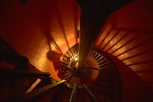 Spiral staircase in the kerosene fueled Elbow Cay lighthouse in the Abacos Islands, Bahamas. - Onne van der Wal