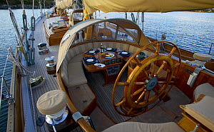 """Cockpit of a 105ft Bruce King ketch """"Whitehawk"""" with the table set for dinner, anchored in Mackerel Cove, Rhode Island, USA.  -  Onne van der Wal"""