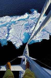 Looking down the mast of 88ft Sloop ^Shaman^ from about 100 ft with the feet of the photographer in view, Spitsbergen, Svalbard, Norway.  -  Onne van der Wal