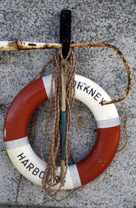 Life saving ring on harbour wall at Stromness harbour, Orkney, Scotland. - Ian Cameron