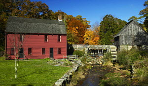The house where artist Gilbert Stuart was born in 1755, in Saunderstown, Rhode Island. An example of a typical New England wooden clapboard house with a water wheel on the right of the house. Stuart w... - Onne van der Wal