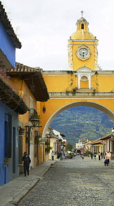 Old clock tower and colourful buildings on the cobbled streets of Antigua, Guatemala. - Onne van der Wal