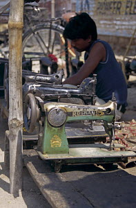 Repairing and selling sewing machines in a region which offers many different kinds of fabrics. Janakpur, Nepal. May 2000. - Lenaïc Gravis and Jocelyn Blério