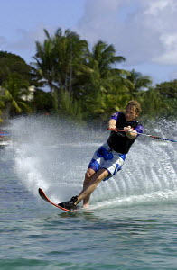 Man waterskiing at Shandrani Hotel Beach in the Blue Lagoon of Mauritius Island, Indian Ocean. July / August 2004.  -  Franck Socha