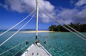 From aboard 88ft sloop ^Shaman^, people swimming off a small island in the Vava'u group, Tonga, South Pacific.  -  Onne van der Wal