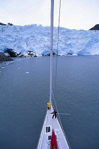 """Masthead view aboard 88ft sloop yacht """"Shaman"""" of the foot of a glacier, Alaska. Model and Property Released.  -  Onne van der Wal"""