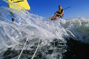 Woman surfing with the Escape dinghy.  -  Onne van der Wal