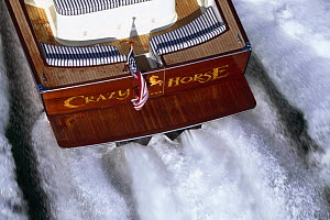Close up of transom on motorboat ^Crazy Horse^ and the wake behind.  -  Onne van der Wal