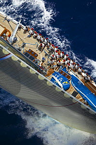 """Looking down the forestay of J-Class """"Ranger"""", with the crew seated along the upside gunwale during Antigua Classic Yacht Regatta 2005, Caribbean. Property Released.  -  Onne van der Wal"""