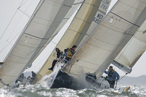 Racing upwind in a tightly packed fleet during the North Sea Regatta off Holland, May 2005. - Richard Langdon