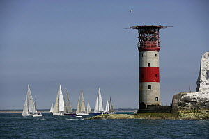 Yachts competing in the JPMorgan Round the Island Race with The Needles Lighthouse in the foreground, Isle of Wight, England, UK. 18th June 2005. ^^^Super-maxi ^Maximus^ took line honours finishing th...  -  Barry Bland
