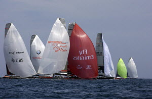 "Emirates ""Team New Zealand"" powers downwind forcing ""Victory Challenge"" (SWE63) to gybe in a tightly packed fleet race during the Louis Vuitton Acts in 2005, Valencia, Spain. ^^^Emirates ""Team New Zea... - Franck Socha"