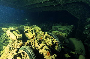 Motorbikes and other cargo aboard the wreck of the SS Thistlegorm, located in the Straits of Gubal, Northern Red Sea. She was sunk by German bomber planes in World War II ^^^and has lain at the bottom...  -  Angelo Giampiccolo