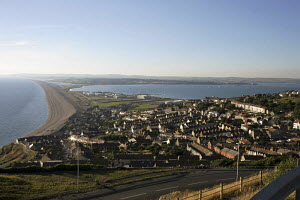 View of Chesil beach and causeway, looking north from Portland, Dorset, England.  -  James Boyd