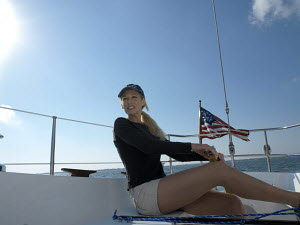 """Woman helming a Swan 36 """"Eolo"""" in Tampa Bay on the west coast of Florida, USA 2003. Model released. - Gary John Norman"""