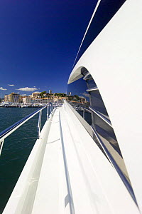 Continental 80 motor boat heading toward Cannes old harbour, France.  -  Angelo Giampiccolo