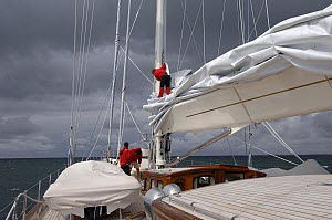 """Crew working on 180ft Superyacht """"Adele"""" as she sails from Marstrand in Sweden.  -  Rick Tomlinson"""