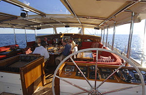 """Guests on board 180ft """"Adele"""" dining al fresco on deck, during her maiden voyage. ^^^ Adele is a 180-foot Andre Hoek designed yacht, built by Vitters Shipyard, Holland, and owned by Jan-Eric Osterlun...  -  Rick Tomlinson"""
