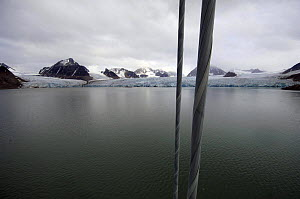 """Superyacht """"Adele"""" makes her way along the spectacular mountain coast of Spitsbergen (also know as Svalbard) in Norway, during her maiden voyage in 2005. ^^^ Adele is 180 foot Andre Hoek design, buil...  -  Rick Tomlinson"""