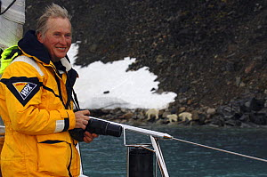 "Jan-Eric Osterlund, owner of superyacht ""Adele"", photographs the local wildlife, during the yacht's maiden voyage to Spitsbergen, Norway. ^^^ The 180-foot yacht is an Andre Hoek design, built by Vitte...  -  Rick Tomlinson"