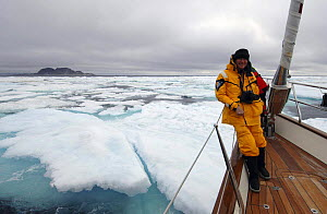 "Owner Jan-Eric Osterlund on the deck at the bow of Superyacht ""Adele"", during her maiden voyage through the icy waters of Spitsbergen, in Norway's Arctic Circle. ^^^ Osterlund has created in Adele his...  -  Rick Tomlinson"