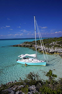 Shannon Shoalsailor moored alongside the shoreline with a family playing in the water. This innovative beachboat is a shallow draft boat designed to roam shallow waters such as these in Exuma, the Bah...  -  Onne van der Wal