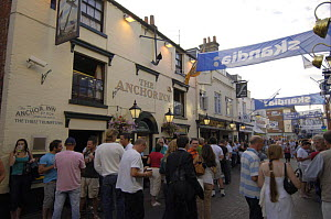 Cowes High Street during Skandia Cowes Week. People walk past the Anchor Inn. - Rick Tomlinson