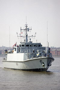 """Warship """"HMS Walney"""" in the River Mersey, waiting to enter the Albert Dock, Liverpool All non-editorial uses must be cleared individually. - Graham Brazendale"""