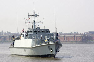 """Warship """"HMS Walney"""", in the River Mersey, waiting to enter the Albert Dock, Liverpool UK. All non-editorial uses must be cleared individually. - Graham Brazendale"""