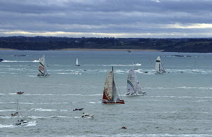 Trimaran fleet and spectator boats at the start of the 7th Route du Rhum, St Malo, France. 10th November 2002. For EDITORIAL use only. - Yvan Zedda