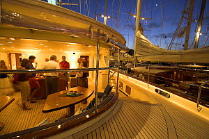 A party onboard a superyacht docked for the night during the St. Baths Bucket Regatta, St Barthelemy, Caribbean.  -  Onne van der Wal
