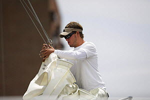 Bowman onboard a classic boat attaching the genoa haliard ready for the hoist.  -  Onne van der Wal
