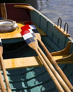 Red, white and blue oar blades and a lifering on the deck of a boat at the Newport Wooden Boat Show, Rhode Island. - Onne van der Wal