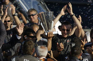 """Team New Zealand"" with the Louis Vuitton Cup trophy after winning the fifth and last match of the Louis Vuitton Cup Final and becoming the new official Challenger to the 2007 America's Cup, Valencia,...  -  Franck Socha"