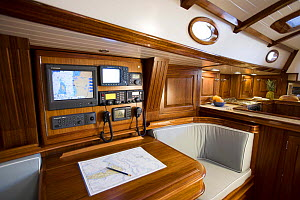 Interior of the Fontaine 53 cruising yacht with navigation desk, Rhode Island, USA. October 2006.  -  Onne van der Wal