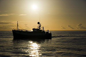 Commercial fishing trawler fishing on the North Sea in perfect weather. July 2007. - Philip Stephen
