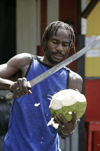 Man slicing a coconut with a large knife, Guadeloupe, Caribbean. February 2006. - Richard Langdon