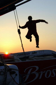 Silhouette of Jacques Vincent jumping on board ORMA 60 trimaran ^Brossard^, during training for the two-handed Transat Jacques Vabre (TJV) 2007. For EDITORIAL use only - Yvan Zedda