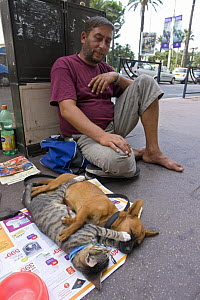 A tramp with his animals begging for money on the Croisette, Cannes, France.  -  Angelo Giampiccolo