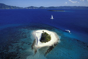 Aerial view of motorboat and charter sailing yacht moored near the uninhabited island of Green Cay, British Virgin Islands, Caribbean. - Neil Rabinowitz