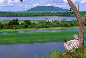 Man looking at view over Pantanal NP World Heritage Site Brazil South America  -  Pete Oxford
