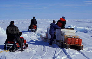 Martha Holmes, Doug Allan and Inuit guides on skidoos Canada - Sue Flood