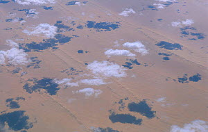 Aerial view of clouds over desert with shadows on land Somalia - Jean E. Roche