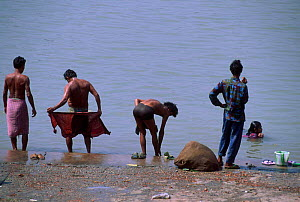 People bathing in Hugli River Calcutta West Bengal India - Pete Oxford